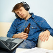 Man fell asleep at home on couch with a beer — Stock Photo