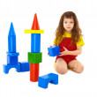 Stock Photo: Child builds a toy castle on floor