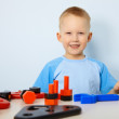Happy child playing with toys — Stock Photo #5562087