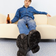 Drunk dude sprawled on couch — Stock Photo