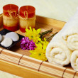 Tray of towels, candles and pebbles - spa — Stock Photo #5586893