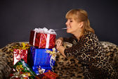 Beautiful woman gets a lot of gifts — Stock Photo