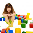 Royalty-Free Stock Photo: Angry little girl among the scattered toys