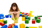 Angry little girl among the scattered toys — Stock Photo