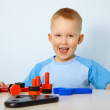 Stock Photo: Happy little boy playing with toys