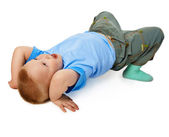 Child tries to do a gymnastic stance on floor — Stock Photo