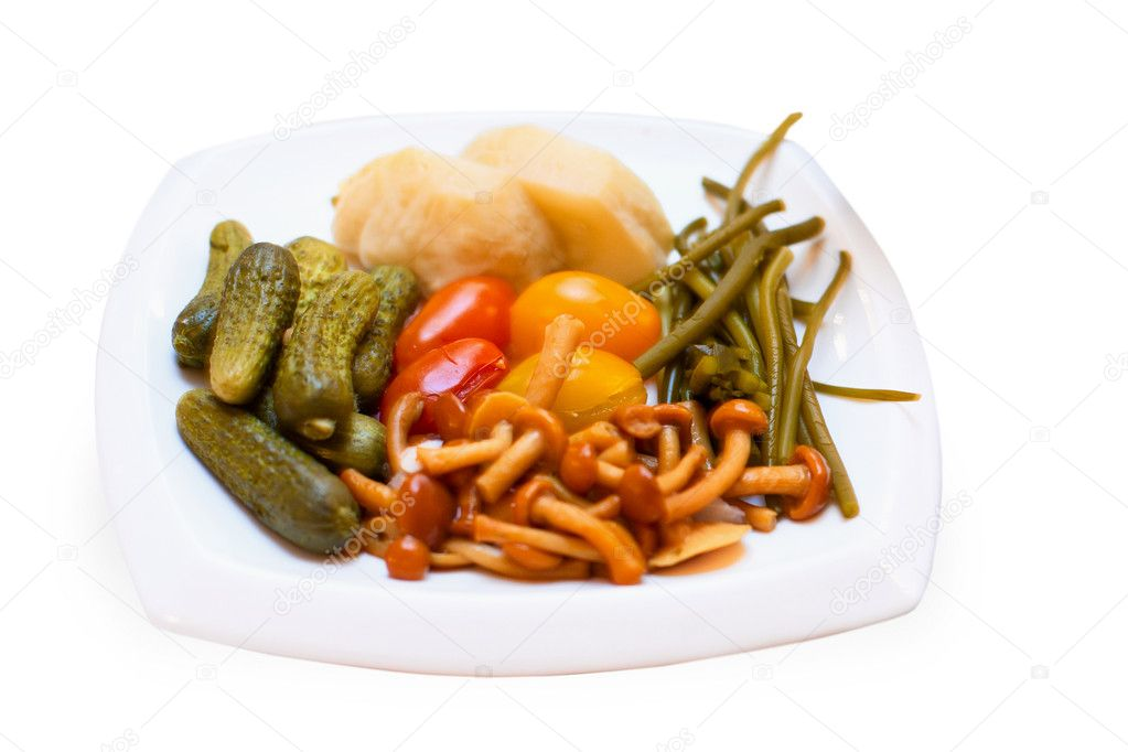 Pickled vegetables on the plate isolated on white background — Stock Photo #5661951