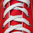 Stock Photo: Red old-fashioned gym shoe - lacing