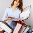Stock Photo: Female accountant and financial documentation