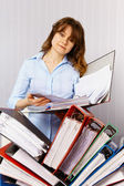 Female accountant and financial documentation — Stock Photo