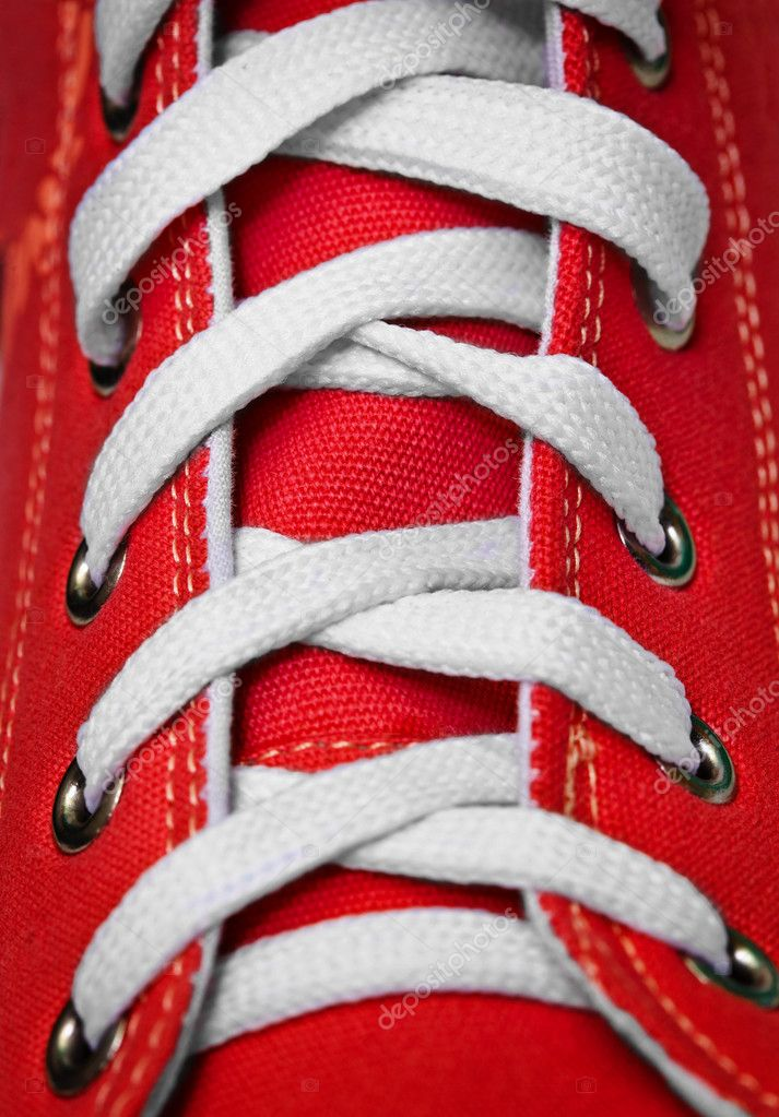 On red old-fashioned gym shoes a lacing close up  Stock Photo #6157136