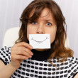 Woman with very unnatural smile on face - Stock Photo