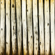 Dilapidated old wooden fence - rural background — Stock Photo