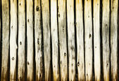 Dilapidated old wooden fence - rural background — Fotografia Stock
