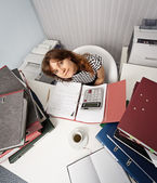 Young woman - financier on office workplace — Stock Photo