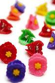 Small colored plastic hair clips — Stock Photo