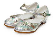 Beautiful silver shoes for girl on white — Стоковое фото