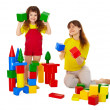 Mom and daughter playing with blocks — Stock Photo