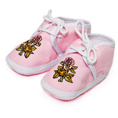 Baby pink booties with flowers — Stock Photo