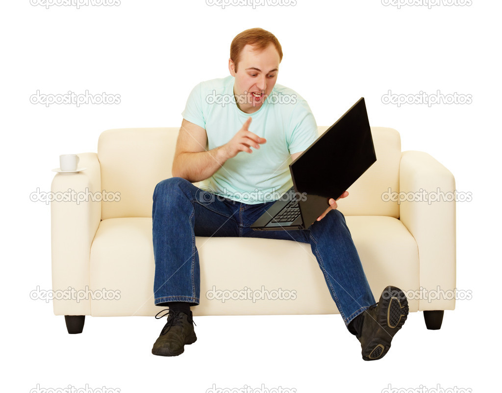 The man was talking with a computer sitting on the couch — Stock Photo #6523892
