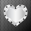 Vector illustration of a silver heart on metal background - Stock Vector
