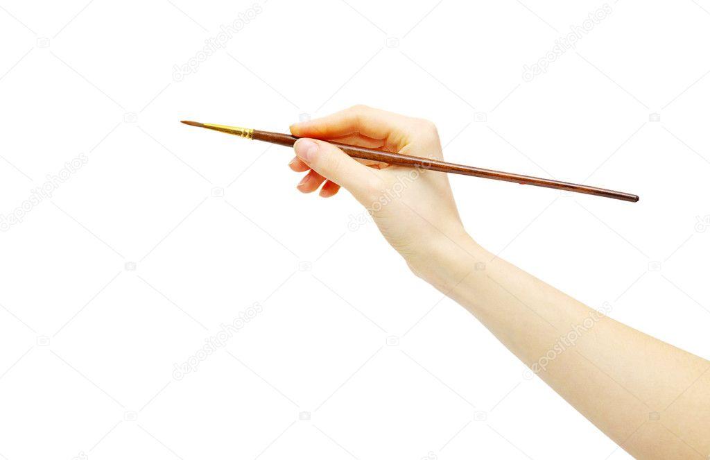 Рука с кистью рисовать