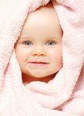 Baby under blanket — Stock Photo