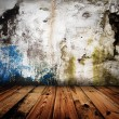 Old grunge wall and wooden floor in a room — Stock Photo