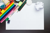 Blank sheet of paper with colorful artist instruments creative p — Stockfoto
