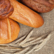 Stock Photo: Variety of fresh bread with ears of rye