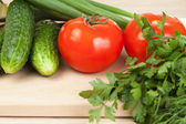 Fresh vegetables on the hardboard — Stock Photo