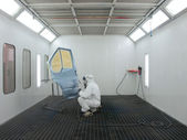 Painter works in a spray booth — Stock Photo
