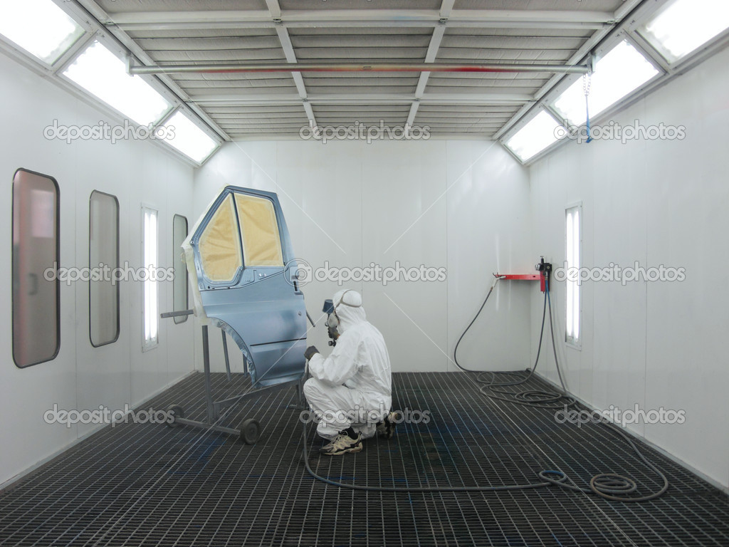 The image of painter works in a spray booth — Stock Photo #5951487