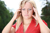 Girl suffers from migraine — Stock Photo