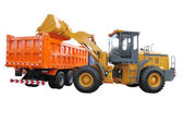 Tractor-loader loads the truck — Stock Photo