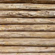 Wooden logs wall of rural house background — Stok fotoğraf