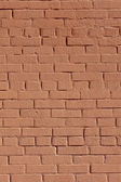 Background with old red painted brick wall — Stock Photo