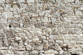 Background from high detailed fragment stone wall — Foto Stock