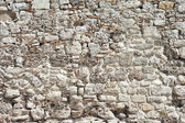 Background from high detailed fragment stone wall — Photo