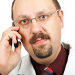 Doctor talking on a cell phone — Stock Photo #6247229