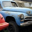 Stock Photo: Vintage Rusty Cars in Museum