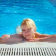 Foto de Stock  : Young Girl Resting at Swimming Pool Border