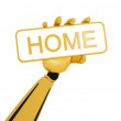 "Gold robotic hand hold a plate with word ""home"". - Stock Photo"