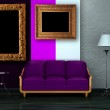 Purple couch with table, picture frames and lamp in double colored room — Stock Photo #5937802