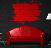 Red sofa, table and standard lamp with splash frame on the wall — Stock Photo