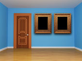 Blue room with door and picture frames — Stock Photo