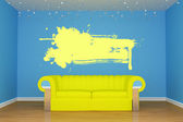 Blue living room with yellow couch and splash frame — Stock Photo