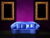 Blue sofa with purple part of the wall in minimalist interior — Stock Photo