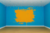 Blue empty room with orange splash on the wall — Stock Photo