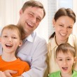 Happy parents with two children — Stock Photo